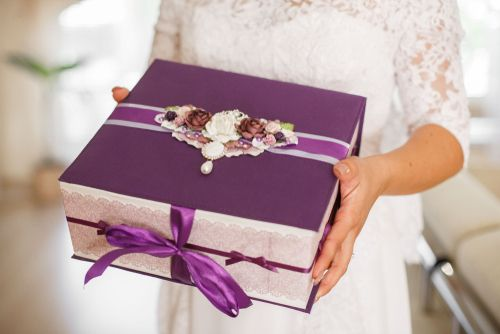 Bride Holding a Purple Gift