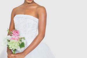 Bride holding bouquet in wedding dress