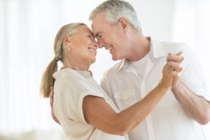 Romantic Older Couple Dancing At Home