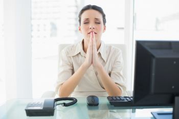 Woman Praying at Work
