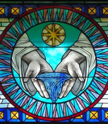 Stained glass window depicting a baptism