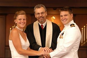 A minister marrying a couple at their wedding